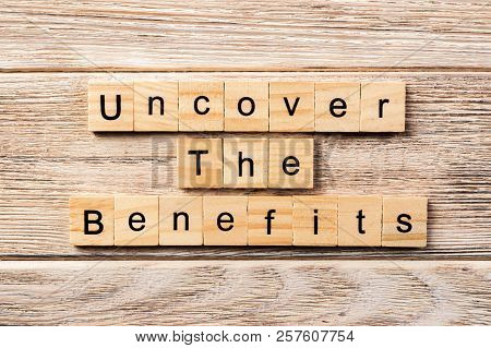 Uncover The Benefits Word Written On Wood Block. Uncover The Benefits Text On Table, Concept.