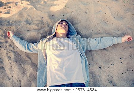 Toned Photo Of Young Man On The Sand Outdoor
