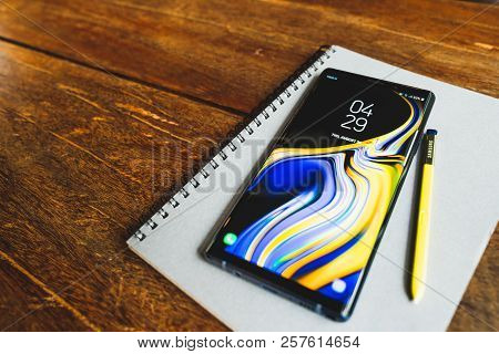 Bangkok, Thailand - Aug 30, 2018: Ocean Blue Samsung Galaxy Note 9 With Yellow S Pen Stylus On A Not
