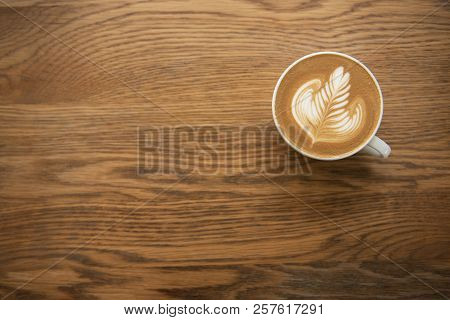 Latte Or Cappuccino With Frothy Foam, Coffee Cup Top View On Wood Table In Cafe.