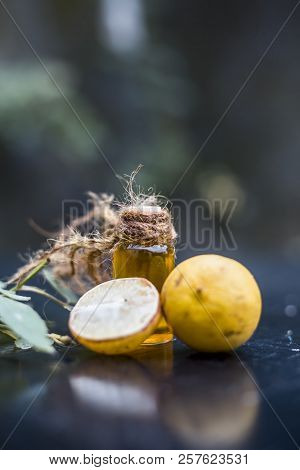 Close Up Of Floral And Herbal Essence Of Lemon Or Limbo Or Citrus × Limon In A Transparent Bottle Wi