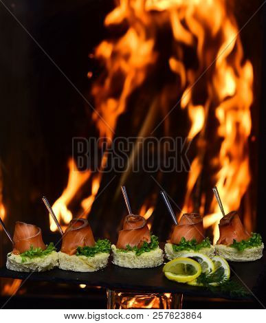 Toasts With Salmon On Burning Flame Background. Healthy Breakfast With Wholemeal Bread Toasts With R