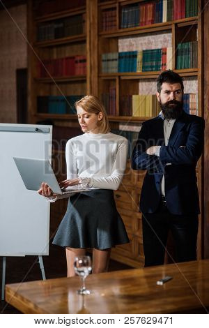 Notebook Concept. Sensual Woman Use Notebook Computer. Business Man And Woman Surfing Internet With