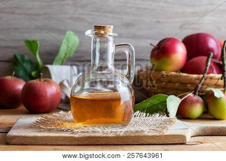 A Bottle Of Apple Cider Vinegar On A Table