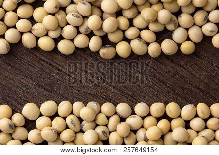 Close Up Soybean On Wooden Table. Top View.