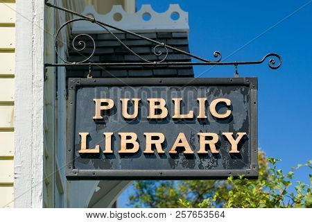 Weathered Hanging Public Library Sign