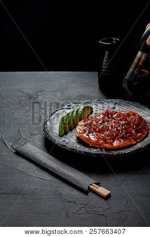 Okonomiyaki, Traditional Japanese Savory Pancake With Sliced Avocado And Fish With Sauce