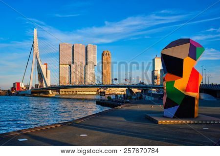 ROTTERDAM , NETHERLANDS - MAY 14, 2017: Rotterdam cityscape with Erasmus bridge over Nieuwe Maas river on sunset. Netherlands