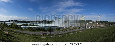 Tourists View The Niagara Falls From The American Side
