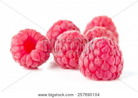 Heap Of Ripe Raspberry Isolated On White Background