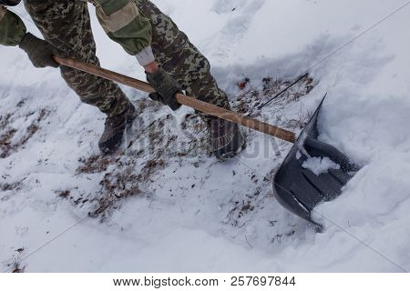 Man Clears The Yard Of Snow With Shovel. Heavy Snowfall In Winter. High Level Of Snow. Snowy Snowdri