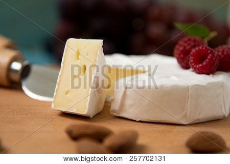 Cheese Camembert With Raspberries And Nuts, Melange