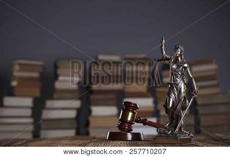 Lawyer Office. Gavel, Themis And Legal Books On Wooden Desk.