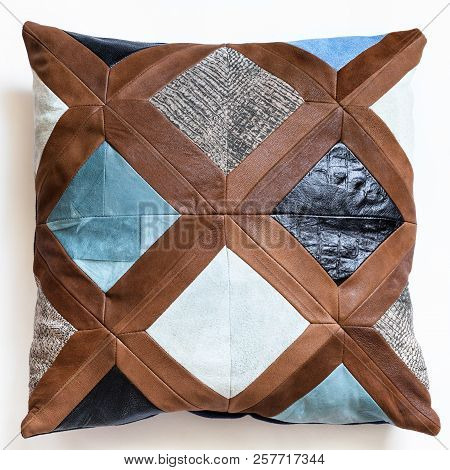 Top View Of Patchwork Leather Decorative Pillow On White Background