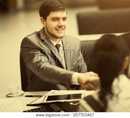 Business People Shaking Hands, Finishing Up A Meeting, In The Office