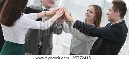 Close Up.boss And Business Team Joining Hands Togethe