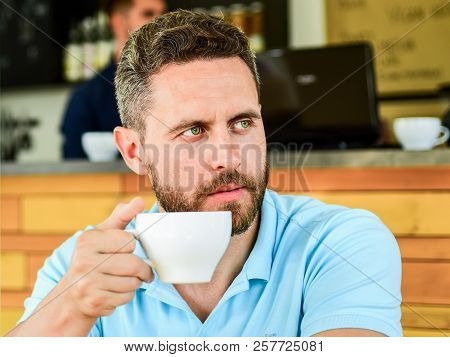 Man Bearded Serious Face Needs Energy Charge. Traditional Coffee Break Cafe Background. Caffeine Mak