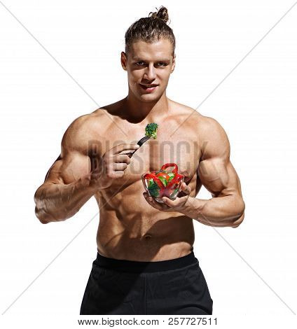 Athletic Young Man With Bowl Of Salad. Photo Of Man Eating Healthy Food On White Background. Organic