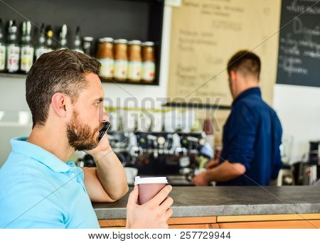 Guy Busy Speak Phone While Relax Coffee Break. Ready To Hear You. Man Holds Cup Of Drink While Have