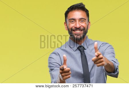 Adult hispanic business man over isolated background pointing fingers to camera with happy and funny face. Good energy and vibes.