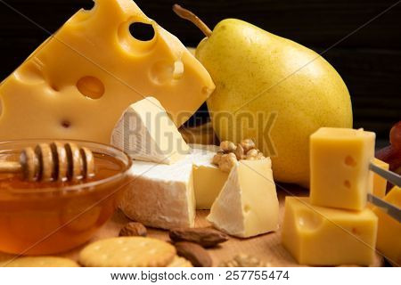 Assortment Of Cheeses With Nuts, Fruits And Honey