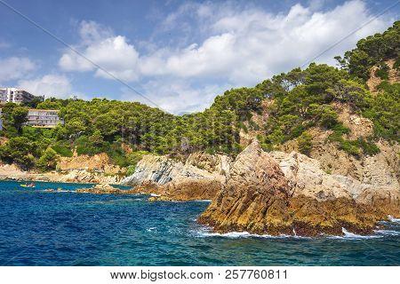 Rocky Coastline Of Mediterranean Sea In Lloret De Mar, Costa Brava, Spain On Sunny Summer Day. Rocks