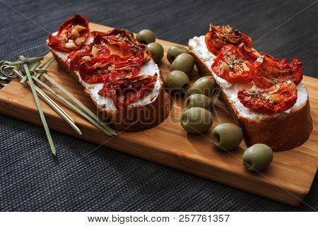 Savory Italian Appetizer Bruschetta Roasted Slices Of Bread With Sun-dried Tomatoes And Cheese.  Bru