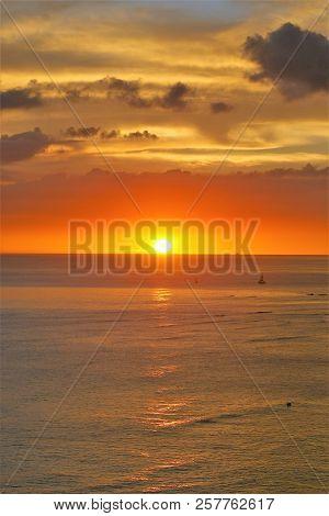 A Dreamy Sunset Over The Ocean Horizon.