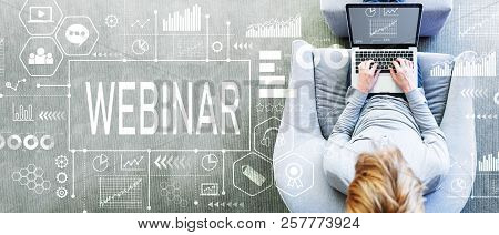 Webinar With Man Using A Laptop In A Modern Gray Chair