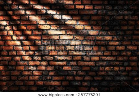 Old Grunge Dark Brick Wall And Sunlight Background