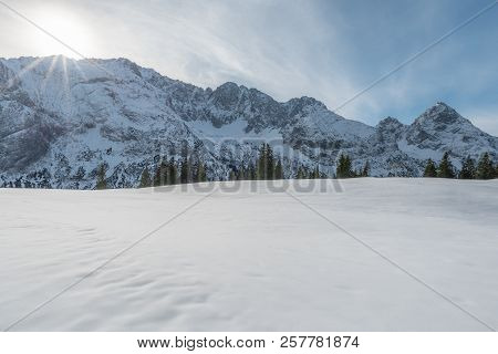 Winter Landscape With The Austrian Alps With Snow-capped Peaks And A Snowy Valley, On A Sunny Day In