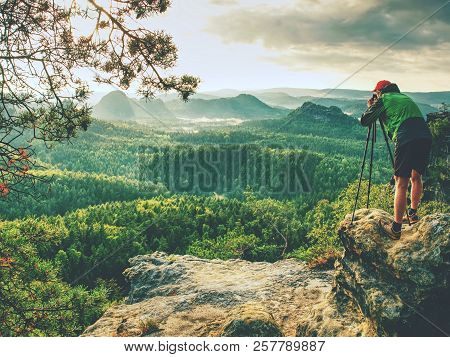 Landscape Photographer Prepare Camera To Takes Impressive Photos Of Misty Fall Mountains. Tourist Ph