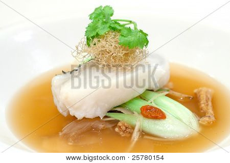 Steamed Fillet Of Cod On A Bed Of Vegetables