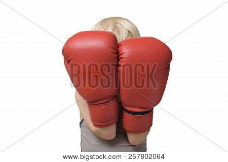 Blond Boy Is Protected In Two Boxing Gloves. Portrait. Isolate
