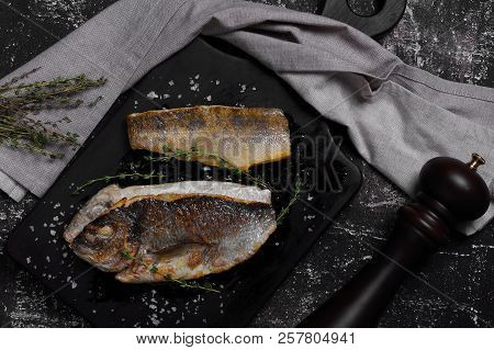 Baked Dorada On A Cutting Board With Thyme
