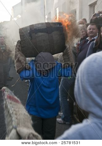 A Young Roller Runs Towards Another Young Roller With A Burning Barrel At The 2011 Tar Barrels Of Ot