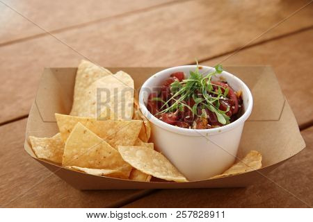 Poke Bowl. Poke Bowl of Raw Tuna with Tortilla Chips and Spices. Sushi Bowl. Raw Fish.  poster