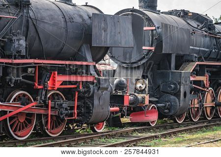 An old disused retro steam black train locomotives on the side track poster