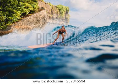 Surf Girl On Long Surfboard. Woman In Ocean During Surfing. Surfer And Ocean Wave
