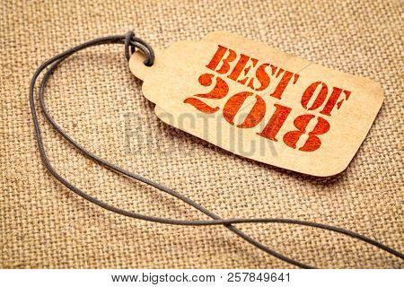 Best of 2018 sign - a paper price tag with a twine iagainst burlap canvas