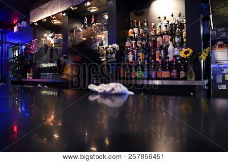 MONTANA, USA - September 9, 2018: Bartender in motion working behind a bar
