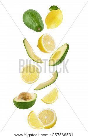 Falling Lemon And Avocado Isolated On White Background