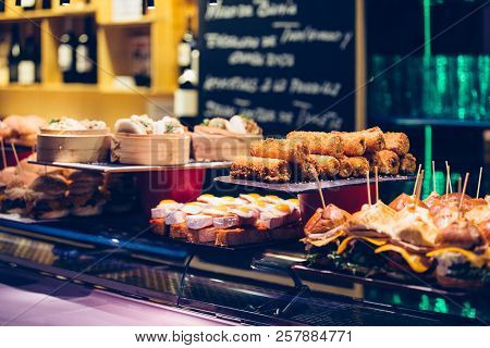 Detail Of Several Trays With A Variety Of Delicious And Tasty Spanish Tapas On A Bar Counter Ready T