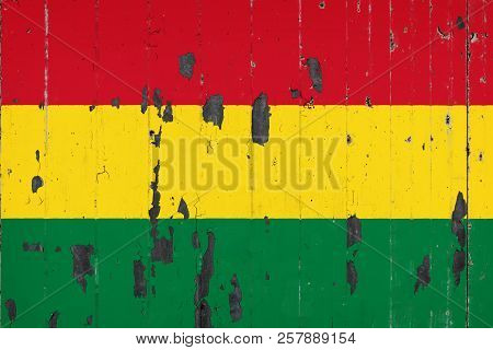 National Flag Of Bolivia On The Background Of An Old Mettale Covered With Peeling Paint