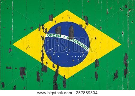 National Flag Of Brazil On The Background Of An Old Mettale Covered With Peeling Paint