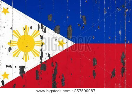 National Flag Of Philippines On The Background Of An Old Mettale Covered With Peeling Paint