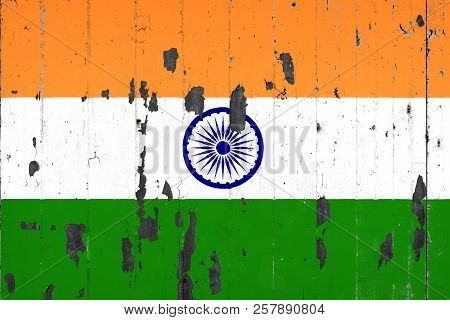 National Flag Of India On The Background Of An Old Mettale Covered With Peeling Paint