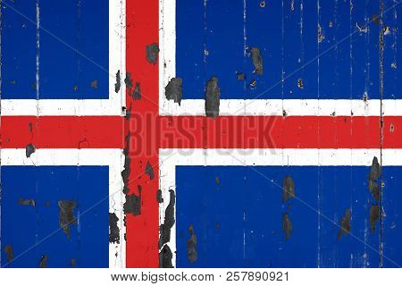 National Flag Of Iceland On The Background Of An Old Mettale Covered With Peeling Paint
