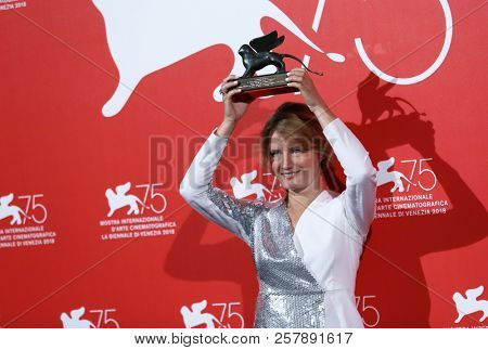 Natalya Kudryashova poses with the Orizzonti Award for Best Actress for 'The Man Who Surprised Everyone' at the Winners Photocall during the 75 Venice Festival on September 8, 2018 in Venice,  Italy.