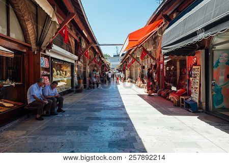 Istanbul, Turkey - August 14: People Shopping At The Arasta Bazaar Located Near The Blue Mosque On A